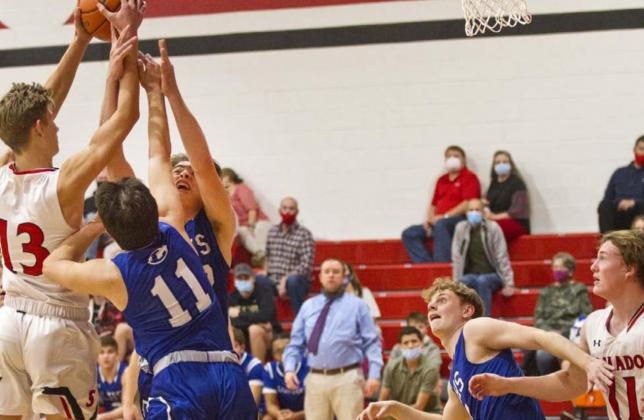 Tak Stinnett (11) and Landon Mulcahy go for a rebound as Quinn Pace (second from right) blocks out against Salado last Tuesday. Lampasas (16-1) brings a 15-game winning streak into the Jan. 12 district opener at Stephenville. On Friday, the Badgers will host No. 21 Glen Rose. JEFF LOWE | DISPATCH RECORD