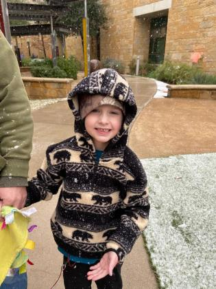 Graysen Hargrove enjoys the winter weather after recovering from heart surgery at Dell children's medical center.