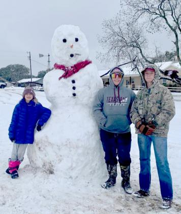 Kim Langford submitted this photo of a snowman who stood 7 feet, 4 inches tall.