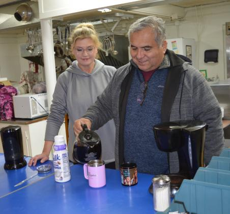 Sheriff Jess Ramos and his wife, Rebecca, serve coffee at St. Mary Catholic Church, which offered a warming station during single-digit temperatures.