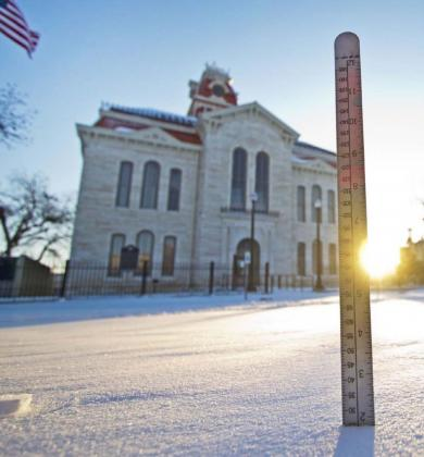 A ruler measures about two inches of snow on the courthouse square Monday morning. Downtown Lampasas was deserted much of the weekend, and high temperatures Sunday were about 40 degrees lower than average for mid-February. JEFF LOWE | DISPATCH RECORD