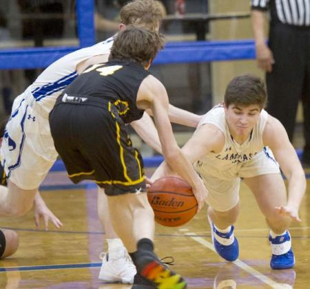 Dax Brookreson (right) dives for a steal. He had seven steals as Lampasas beat Gatesville 89-42 at home on Friday. JEFF LOWE | DISPATCH RECORD