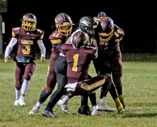 Luis Acevedo (14), Lane Evans (1), DJ Smart (11) and Alonso Caso (3) converge for a defensive stop against Evant. Lometa reached the playoffs for the first time since 2017 and beat the rival Elks for the first time since 2014. MEGAN LUSTY | DISPATCH RECORD