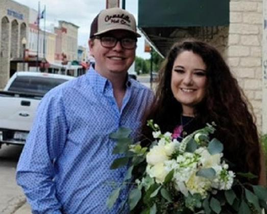 Crosby Green, right, co-owns Petal Peddlers with her husband, Zane. TERESA THORNTON | DISPATCH RECORD